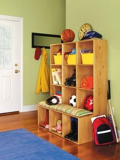 Four unfinished pine modules were combined to create this efficient mudroom unit. To get the look, sand, prep and stain each unit. When fully dry, arrange the three larger modules vertically along your wall and lay the shorter module in front across the floor. Top it off with a soft, colorful cushion for a comfortable shoe-changing station. Shown here: Minwax Pre-Stain Wood Conditioner and Minwax PolyShades® in Classic Oak. | Photo: Courtesy of Minwax