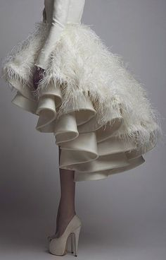 Over the top #weddingdress with #rufflles and #feathers #ELLE