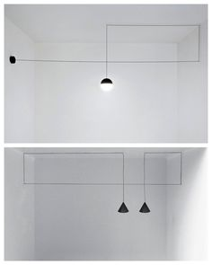 The lamps are hung with thin black electrical cords that draw bold geometric shapes in the air