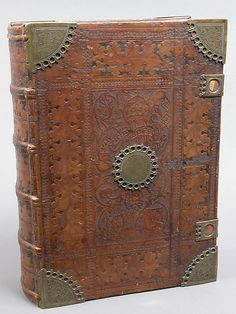 Bible, 1477-78, Nuremberg, Germany, stamped & tooled leather binding with engraved brass fittings.    Metropolitan Museum of Art.