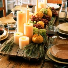 Bring a rustic look to your Thanksgiving table with this centerpiece idea built off a piece of wood or weathered lumber. You'll add in clusters of grapes along with candles of various size to create a real mixed media centerpiece.