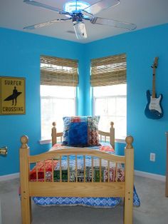The floor space in this small room for a boy transitioning into a teen is maximized by hanging his guitars, skateboards and CD collections on the walls. Discover more kids room decorating and organizing tips and ideas @ http://kidsroomdecorating.net