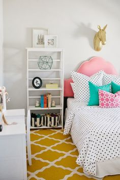 A Girl's Dream Room Reveal - how fun is the gold unicorn over the bed?! #biggirlroom