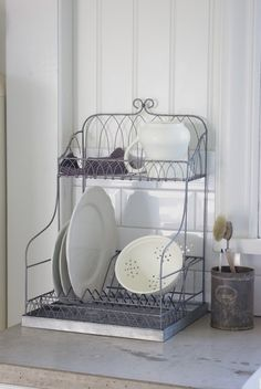Wire dishrack. Would be great in the pantry for a pretty way to store the seldom used dishes.