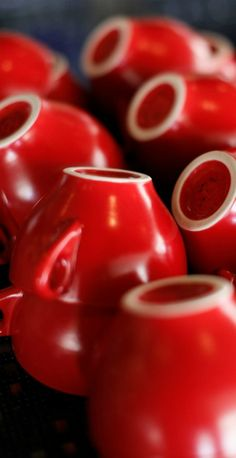 Cherry red coffee cups, made by HF Coors in Tucson, Arizona. 100% #madeinUSA  Available in our Tucson factory store.