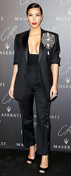 Kim Kardashian wore a sharp black tuxedo by Givenchy to perfection with a plunging top that showed lots of cleavage. A bold pearl broach finished the look.