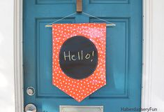 Chalkboard fabric and oilcloth. Greet your guests and neighbors with a warm hello