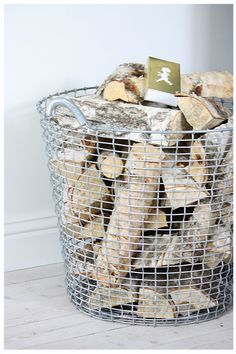 Firewood storage basket...I saw baskets like this at Home Goods Recently