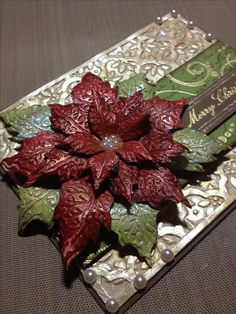 This is a metallic poinsettia flower created using the Tim Holtz tattered poinsettia die and companion embossing folder. poinsettia flower, flower creat