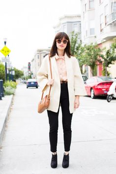 Love the geometric tailoring on this coat