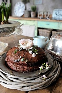 Demure homemade chocolate wedding cake with flowers - like the woven wood too!