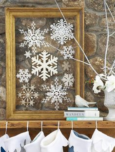 Inexpensive way to decorate - an unused frame, some snowflakes and fishing line.