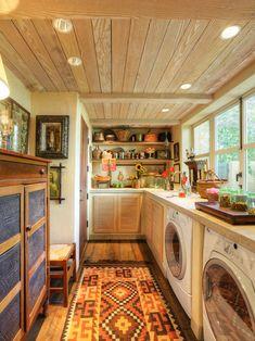 Fab laundry room! wood floors, stone top, unique cabinet door, built ins, old dresser-cabinet.  Love it