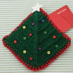 Christmas Tree Gift Card Cozy | AllFreeKnitting.com his DIY gift card holder will add some extra holiday cheer to your Christmas gifts. This Christmas Tree Gift Card Cozy will make your gift cards look personal.