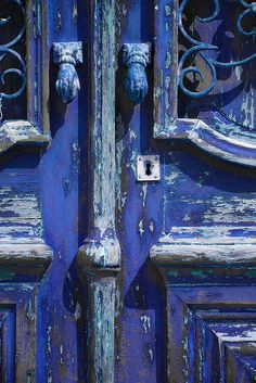 Weathered architecture. The traditional doors of portuguese houses are amazing - colorful and intricate.