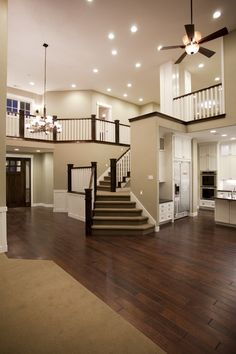 Wood floors, neutral paint, and wood trim, lights