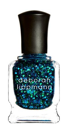 My new favorite. Dark blue jelly, packed with glitter. 3 coats makes a gorgeous layered look, the glitter looks like it is floating. So cool.    I have also layered it over a dark teal and then you only need 2 of this.  PITA to take off but worth it!