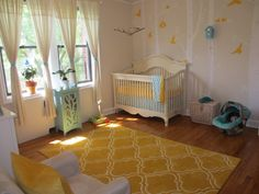 Modern yellow nursery with eclectic accents!