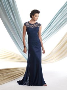 Mother of the Bride Dress from Montage by Mon Cheri, style 113933. Stretch illusion slim A-line dress with hand-beaded embroidered cap sleeves and bateau neckline, pleated sweetheart bodice, soft skirt with sweep train. Matching shawl included. Shown in Navy Blue.
