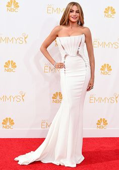 Sofia Vergara fired up the Emmys red carpet in a form-fitting white Antonio Berardi gown. She proclaimed that boyfriend Joe Manganiello didn't accompany her because he's too hot for the red carpet!