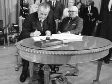 LBJ penned Medicare into law.