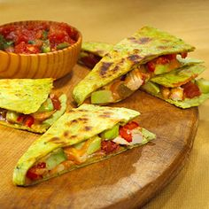 Lightly coat one side of each tortilla with cooking spray. Place tortillas, sprayed sides down, on a cutting board or waxed paper. Sprinkle 1/2 cup of the cheese over half of each tortilla. Top cheese with Grilled & Ready® Fajita Chicken Strips, avocado, jalapeno, and salsa. Fold tortillas in half, pressing gently.