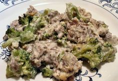 Seems the uglier my food is, the better it tastes.    HAMBURGER-BROCCOLI ALFREDO CASSEROLE  2 pounds ground beef  1 small onion, diced, 2 1/2 ounces  10 ounces frozen broccoli florets  8 ounces cream cheese  1/2 cup heavy cream  1/2 cup freshly grated parmesan cheese  1/2 teaspoon garlic powder  Salt and pepper, to taste