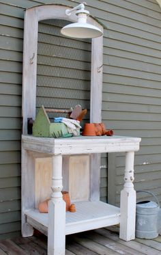 Potting bench made from an antique door, beadboard, porch posts, chicken wire and a working antique light - wow! via HGTV Gardens