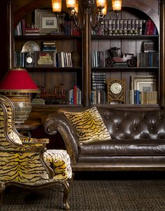 Animal print # Tufted Sofa # Library # Living Room decorating ideas