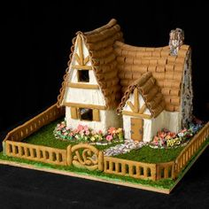 Cute cottage crafted of brown fondant and white royal icing. The decorative flowers are made from gumpaste, which can be sculpted like clay before it hardens to a porcelainlike state. | Photo: Wright Creative | thisoldhouse.com