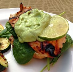 healthy dinner idea: open-faced grilled honey lime chicken sandwiches with avocado lime cream sauce. the sauce is made from avocado, greek yogurt and lime -- soo delicious!