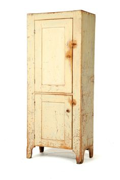 Sold for $3,055 CHIMNEY CUPBOARD.  Attributed to Lebanon County, Pennsylvania, 1st half-19th century, pine. Two paneled doors, good cutout feet, and old cre...