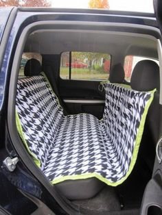 DIY car seat cover for dogs--hammock style keeps them from jumping into the front and keeps them from hurting themselves if there is a sudden stop...and keeps the hair out of the car!