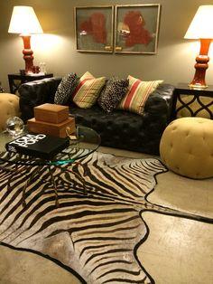 Zebra hide #rug with #tufted #sofa and #coral decor at #Mecox #Chicago #interiordesign #MecoxGardens #furniture #shopping #home #decor #design #room #designidea #vintage #antiques #garden