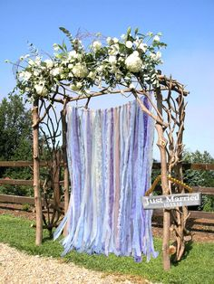 Wedding Garland Floor Length Back Drop - Would be pretty for a ceremony background, or for the reception. Could probably DYI. **Super awkward photoshopping in this picture