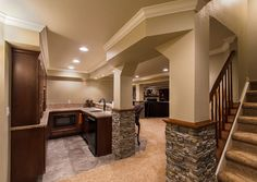 finished basement pictures | basement bar, basement finishing Denver, basement remodeling, basement ... * this is how the pillars should look - maybe wood on the top???