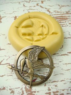 The Hunger Games - Mockingjay - Flexible Silicone Mold - Push Mold, Jewelry Mold, Polymer Clay Mold, Resin Mold, Craft Mold, PMC Mold. $5.99, via Etsy.