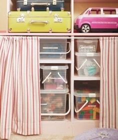 Use curtains to hide storage bins. | 41 Clever Organizational Ideas For Your Child's Playroom