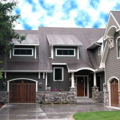 Pretty house!  Love the color, the doors, and the stone work. the doors, custom homes, brown exterior house colors, exterior houses, garage doors, exterior colors, stone, grey exterior house colors, wood doors