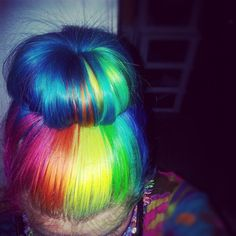 Neon rainbow hair up in a sock bun. ^~^