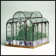 Glass Terrarium on a stand would be perfect, since I ain't gardenin' outside! (yeah, that's right, I said AINT!)