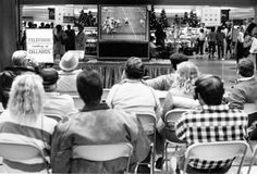 Husker football fans watch the action in Norman, Okla., on the big screen at Crossroads Mall on Nov. 19, 1988. No. 7 Nebraska defeated No. 9 Oklahoma 7-3. THE WORLD-HERALD