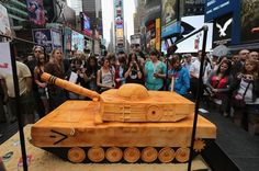 500 pound cake in the shape of a tank after watching a ceremony marking the U.S. Army's 237th anniversary on June 14, 2012 in Times Square in New York City. U.S.