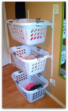 "Love this alternative to the wood basket holders. Although the wood looks more polished and ""built in"", this version is one I could do myself! Home Organizing Ideas – Can We Ever Get Enough of Them"