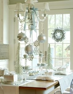 Elegant Christmas // I've always loved white lights, silvery things, and Waterfords around Christmas. Not a fan of the island-ish table here but the colors are great.