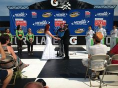 Check out this NASCAR wedding in Victory Lane at Michigan Speedway. Beautiful couple with Danica bridesmaids - awesome!