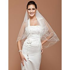 One-tier Fingertip Wedding Veil With Cut Edge .. great as a starting point if you want to make your own fancier veil but are afraid of doing the construction.