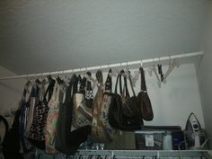 Hang a shower curtain rod in your closet for a place to display your purses
