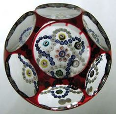 Baccarat overlay paperweight with millefiori garlands and Gridel silhouette canes, ca. 1850. Currier Collections Online.