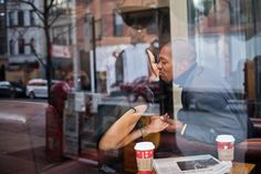 Engaged Couple Kissing in Coffee Shop   photography by http://www.geraldcarvalho.com/